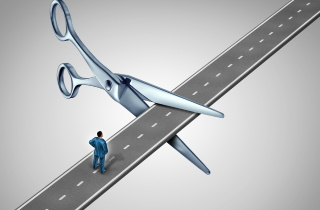 Scissors cutting road