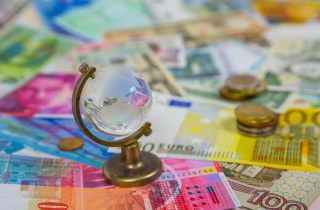 Glass globe on money
