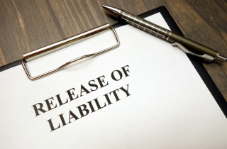 Clipboard with liability release