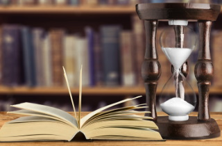Hourglass with book