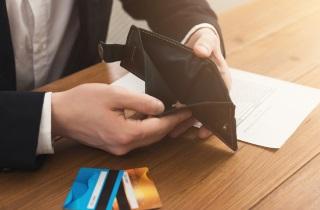 Hands opening wallet