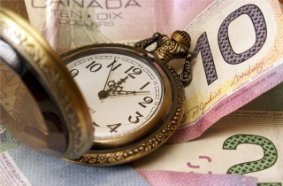 Pocket watch on money