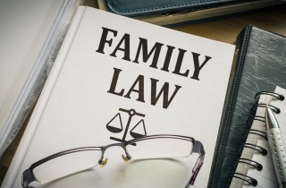 Family law book with glasses