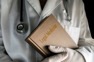 Doctor holds legal book