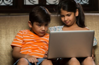 Children sitting with laptop