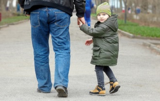 Child walking away with adult
