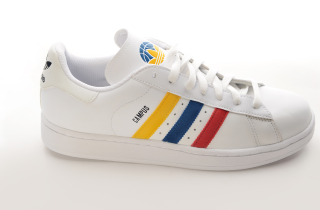 White adidas shoe with red, yellow and blue stripes