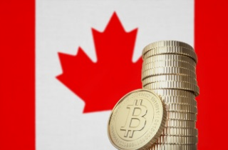 Stack of bitcoin in front of Canadian flag