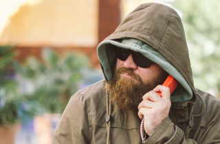 Bearded man on the phone