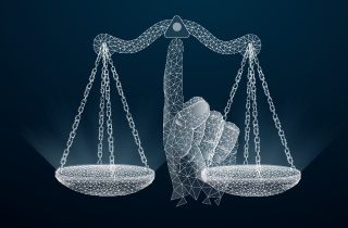 Hand balancing scales of justice