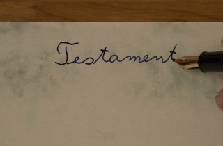 "Hand writing the word ""testament"""