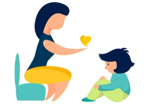 Seated therapist talking with child and giving a heart
