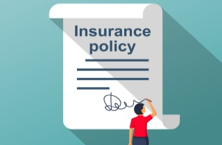 Woman signing insurance policy