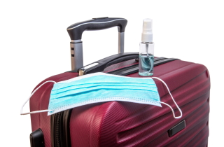 Suitcase with mask and hand sanitizer