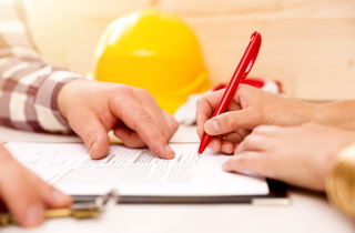 Renovator holding a work estimate
