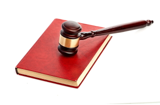 Gavel on red law book