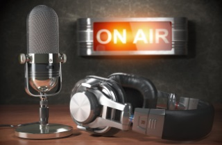 "Microphone, headphones and ""on air"" sign"