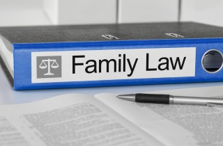 Family law binder with pen and paper