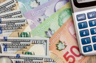 U.S. and Canadian money beside a calculator