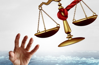 Drowning hand reaching for legal aid help