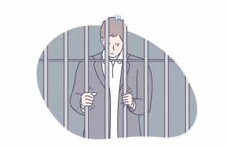 Young man behind bars