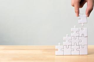 Puzzle pieces building upwards