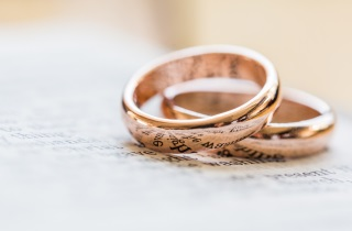 Gold wedding rings on paper