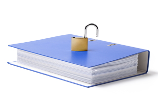 Open padlock on top of stack of files
