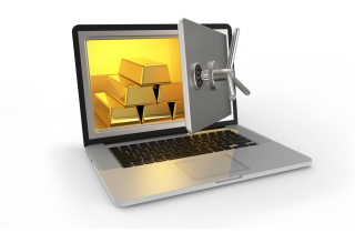 Laptop screen with safe full of gold
