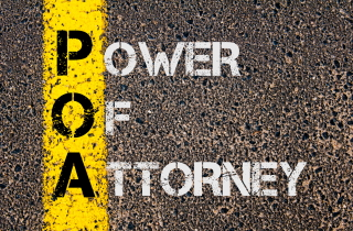 Power of Attorney painted on a street