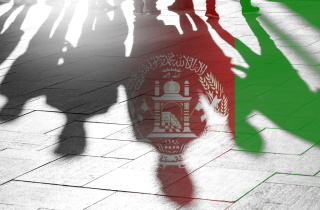 Afghan flag and shadows of refugees