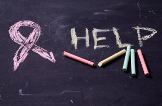 """The word """"Help"""" written on chalkboard"""