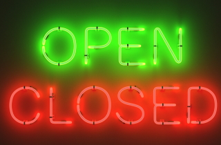 Open sign over a closed sign