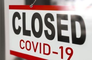 """Sign in window saying """"Closed COVID-19"""""""