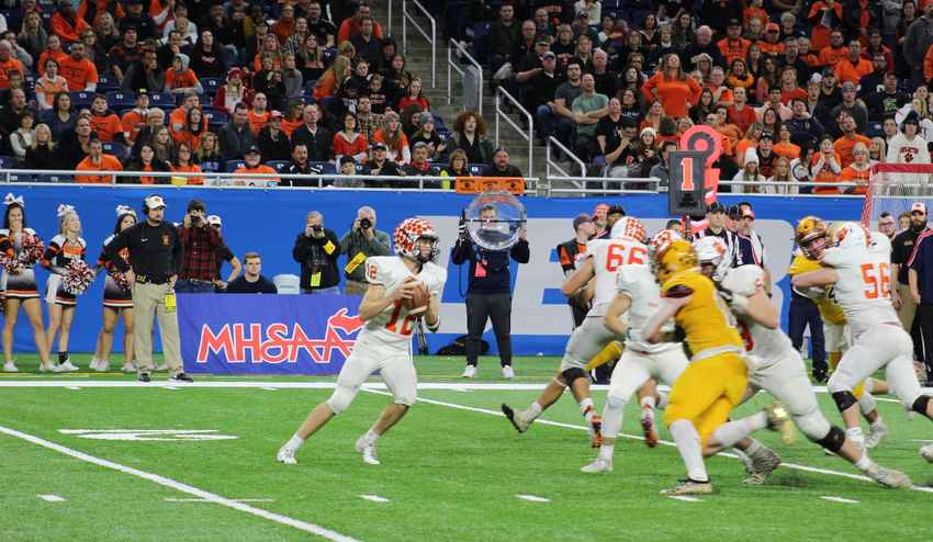 Colby Newburg looks for a receiver in the division one state final against Davison Saturday at Ford Field