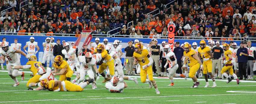 Brendan Sullivan looks for a running lane against Brighton in the division one state final Saturday at Ford Field