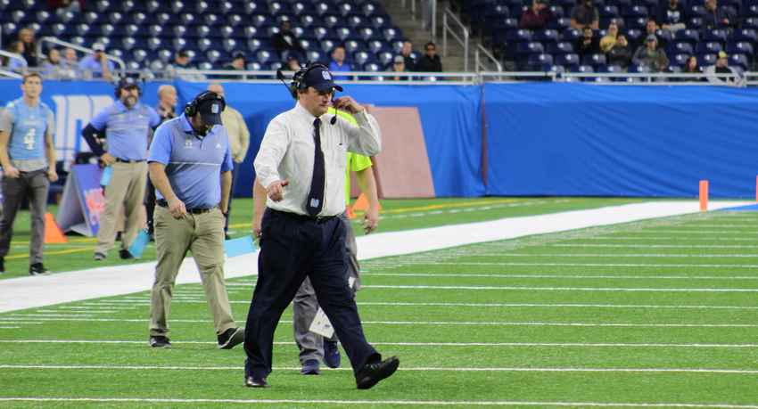 Muskegon Mona Shores Coach Matt Koziak walks onto the field during a timeout Friday at Ford Field