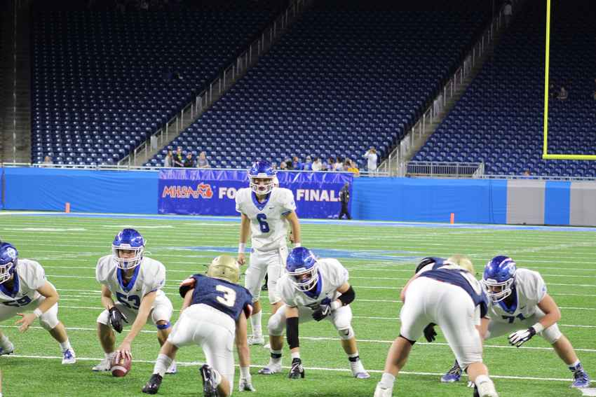 Joe Silveri checks the defense in the division four state final Friday at Ford Field