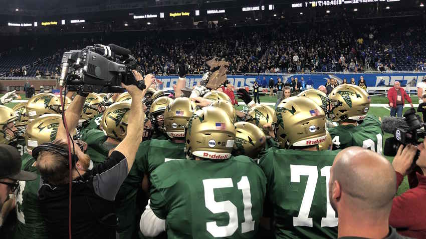Monroe St. Mary Catholic Central celebrates the division six championship Friday at Ford Field.