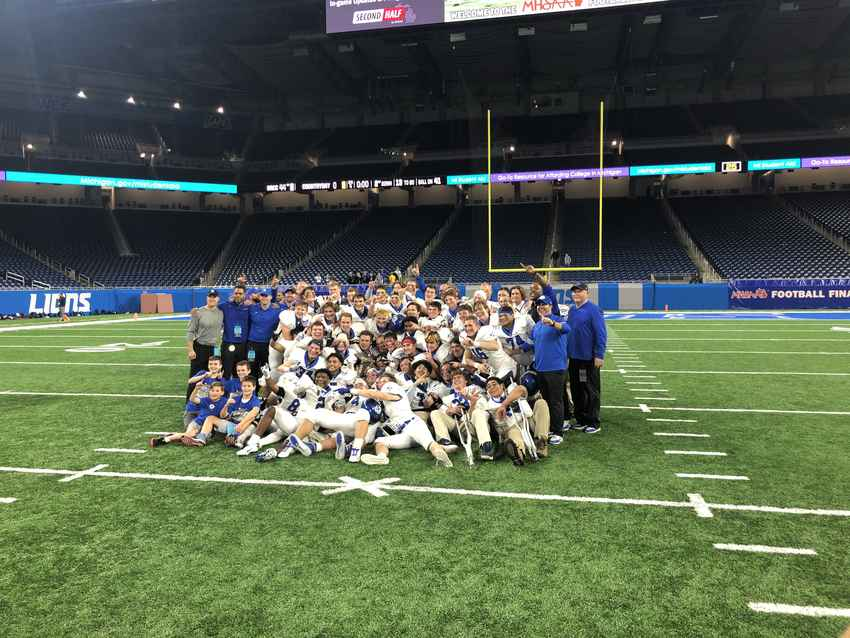 Grand Rapids Catholic Central celebrates the state championship Friday from Ford Field