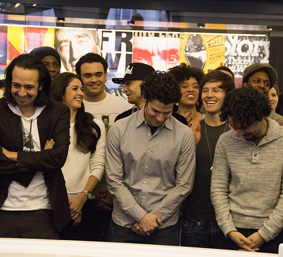 Lin-Manuel Miranda, Thomas Kail, Alex Lacamoire, and the cast of Hamilton celebrate news of the show's impending Broadway transfer from its current home at the Public Theater.