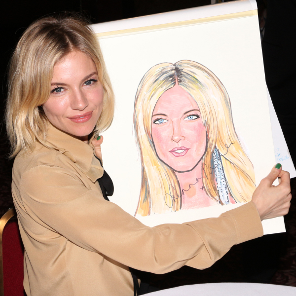 Sienna Miller shows off her brand-new Sardi's caricature.