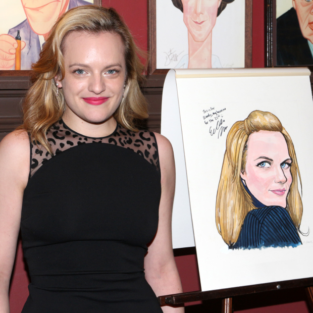 Elisabeth Moss poses with her caricature at Sardi's.