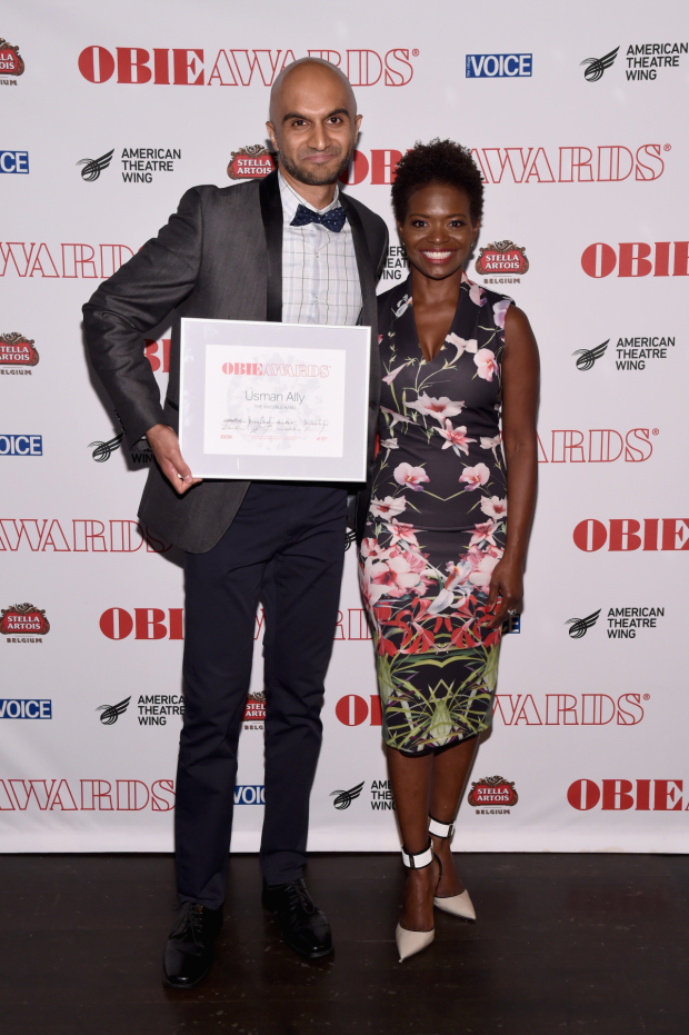 Usman Ally shows off his Obie for The Invisible Hand alongside presenter LaChanze.
