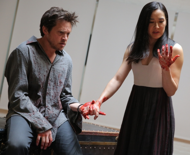 Rob Campbell as Macbeth and Jennifer Ikeda as his wife in the Mobile Shakespeare Unit's production of Macbeth, directed by Edward Torres, at the Public Theater.