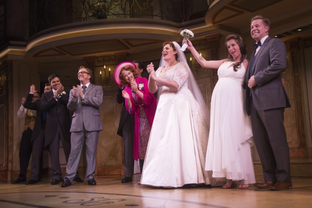 The cast of Broadway's It Shoulda Been You celebrate with newlyweds Jordan Reuck and Matt Harter.