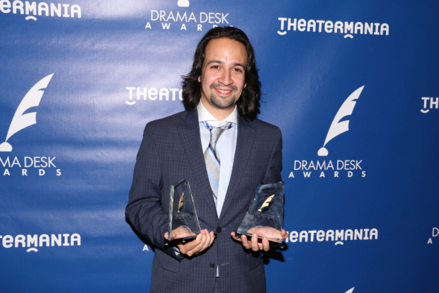 Hamilton's Lin-Manuel Miranda holding two of his three Drama Desk Awards after the ceremony at Town Hall.