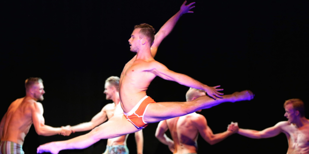Jacob Karr flies through the air during Broadway Bares Fire Island.