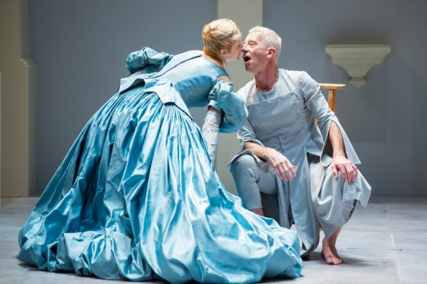 Sofia Jean Gomez as Elmire and Steven Epp as the title character in Molière's Tartuffe, Tartuffe, adapted by David Ball and directed by Dominique Serrand, at Shakespeare Theatre Company.