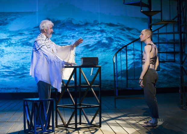 Sam Waterston as Prospero and Chris Perfetti as Ariel in the Public Theater's Shakespeare in the Park production of The Tempest, directed by Michael Greif, at the Delacorte Theater.